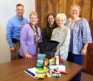 Members of the CJSM Team with the contents of a Backpack of Love.