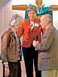 Terri Roberts, Pastor Sadie Pounder, and Bishop Jim Dunlop pray